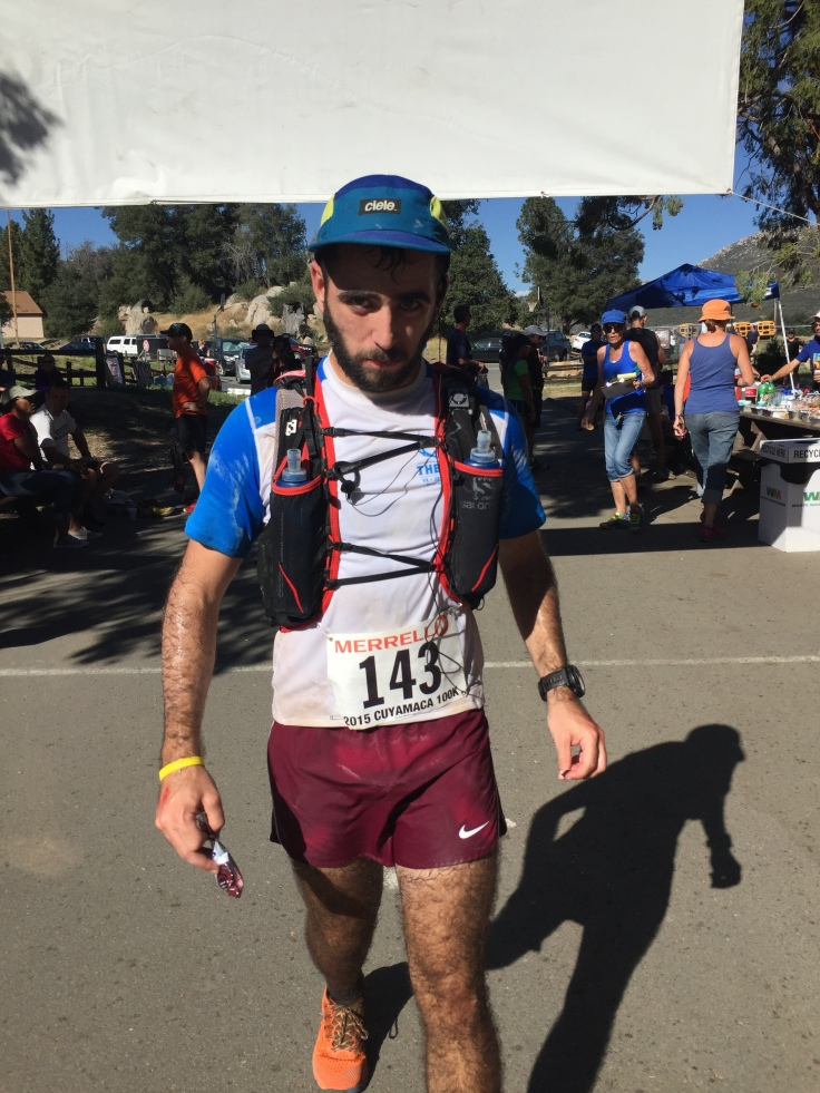 Low point of the race...so tired of Gu and heat. Notice the amount of salt on my hat, shirt, and shorts.