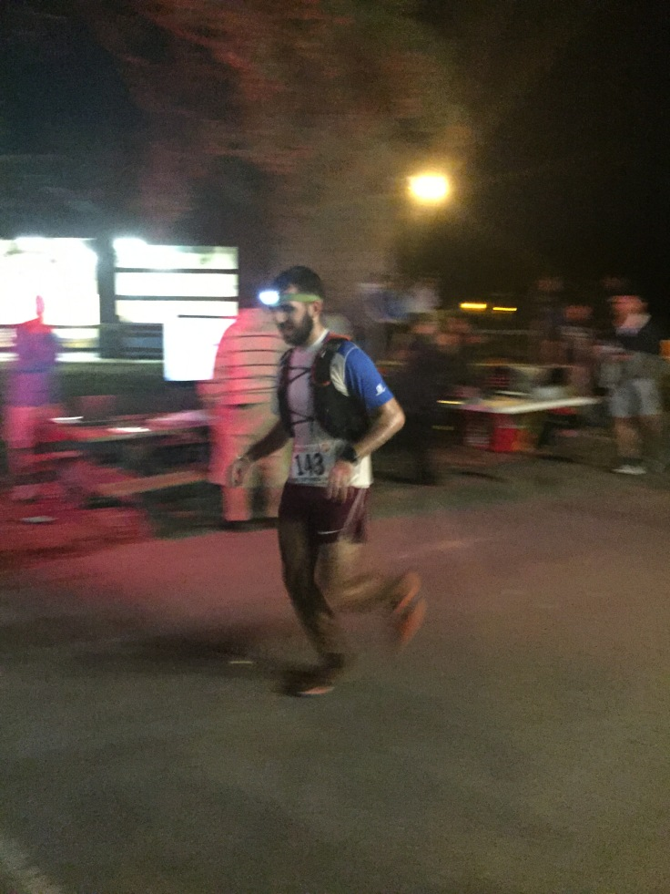 Staring down the finishing line and grimacing my way to the end!